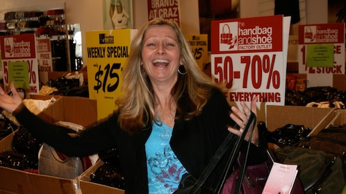 Smiling woman excited about sales at a store in Melbourne