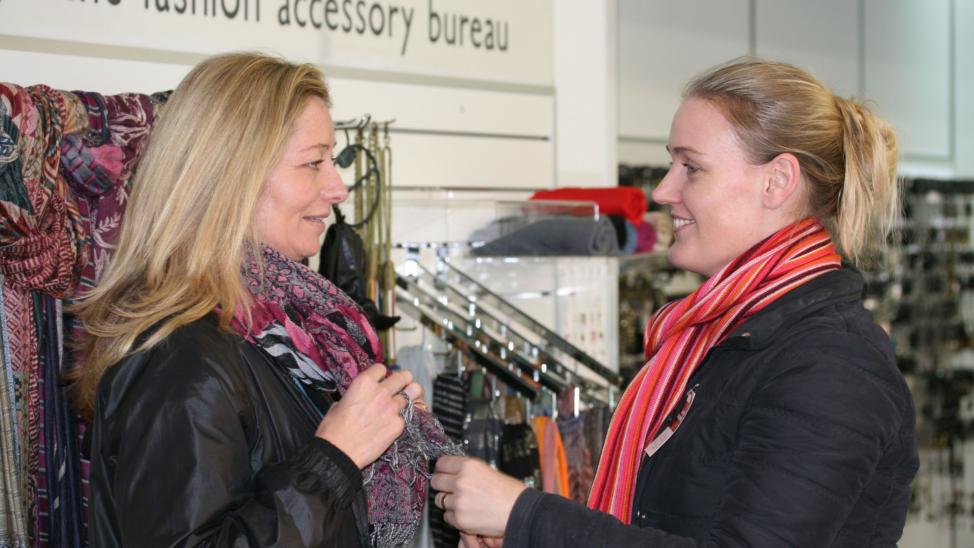 Pair of women shopping for scarves at a store in Melbourne