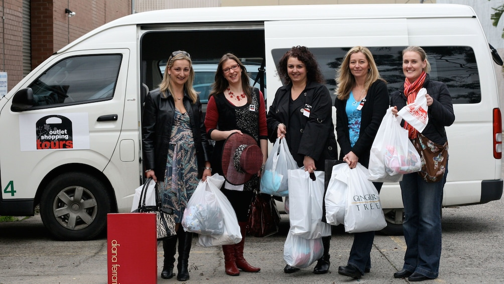 Show item 1 of 6. Shopping group standing in front of tour van after shopping in Melbourne