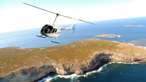 Helicopter flying over the coast cliffs near Melbourne