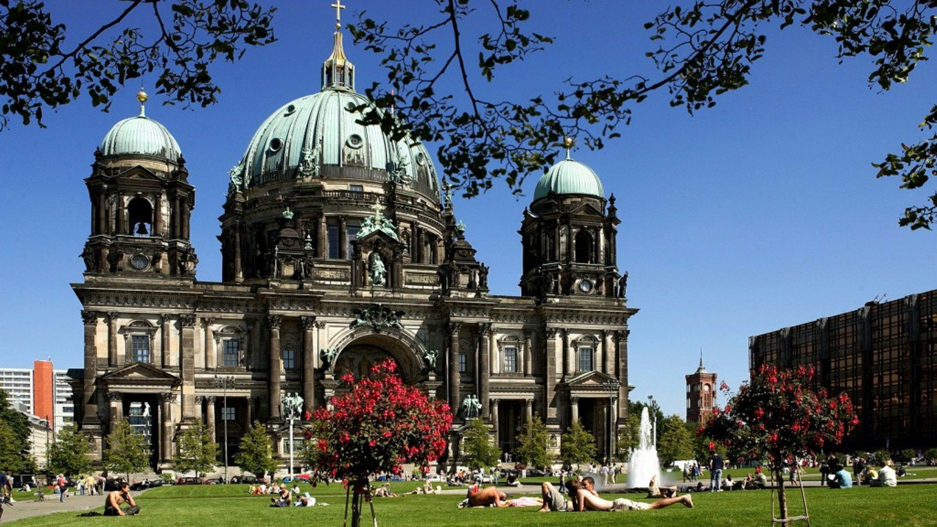 People relaxing in the park outside the Berlin Cathedral