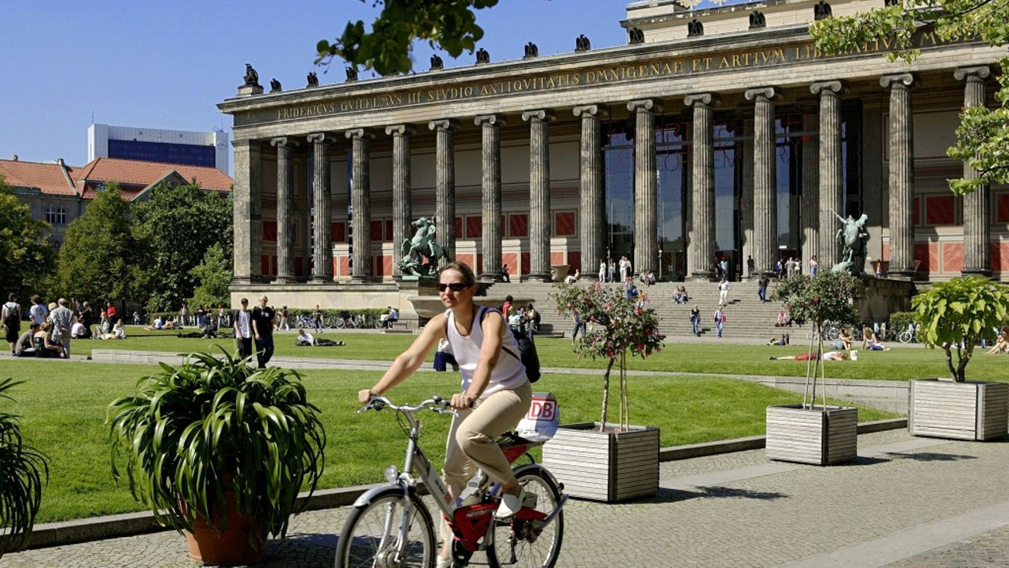 Person riding bicycle in park in Berlin