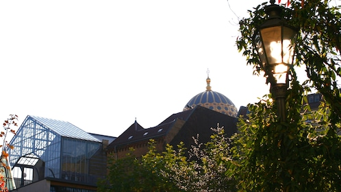 The dome of the New Synagogue peeking over rooftops in Berlin