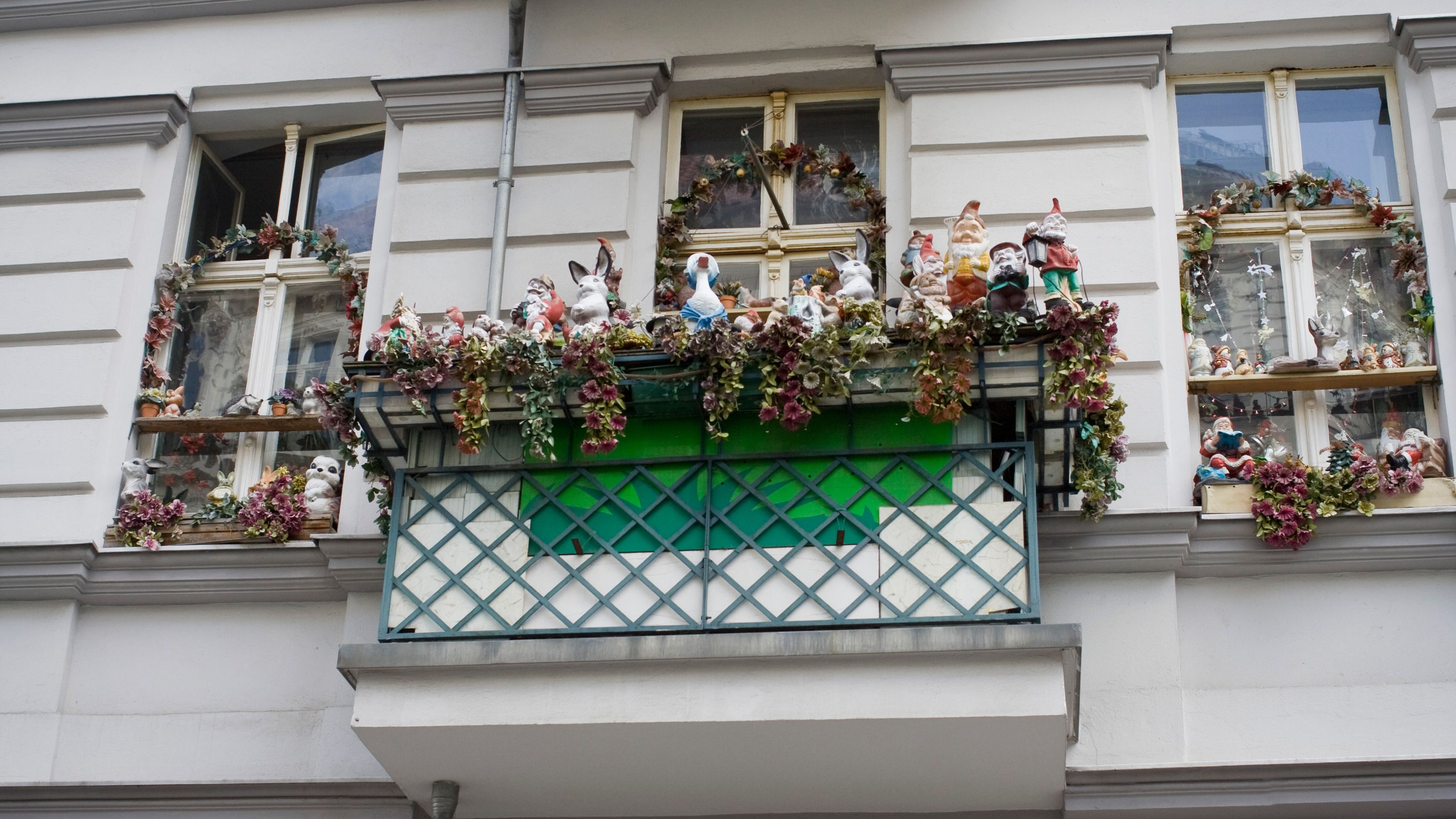 Colorful ceramic figurines on a windowsill in Berlin
