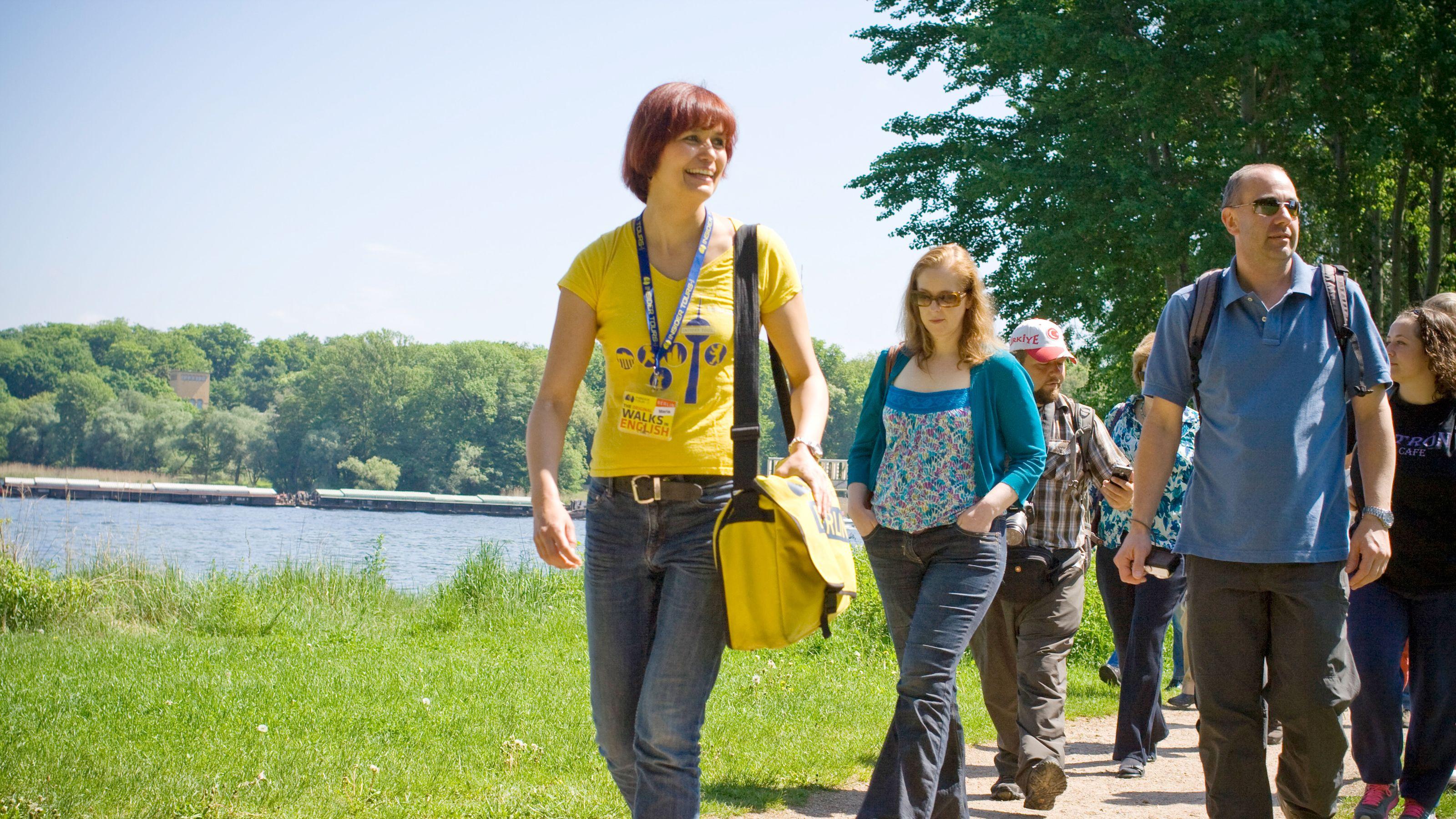 Tour group walking through a park in Potsdam