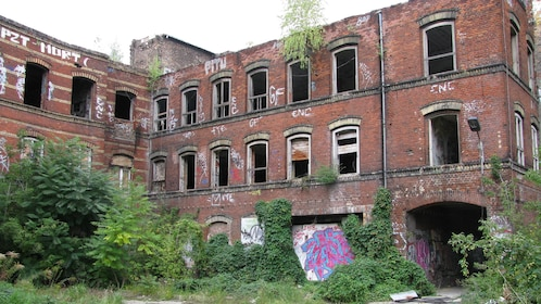 An old brick building with graffiti on its walls in Berlin
