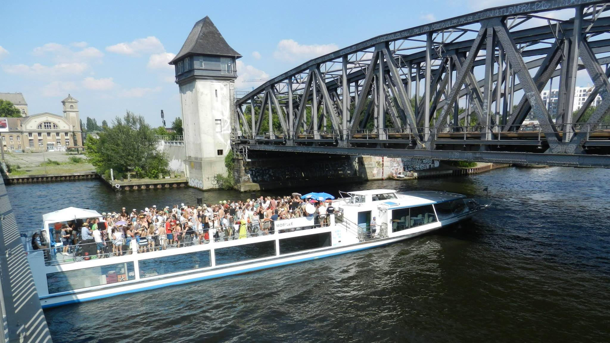 Boat sailing under a bridge on the Spree river