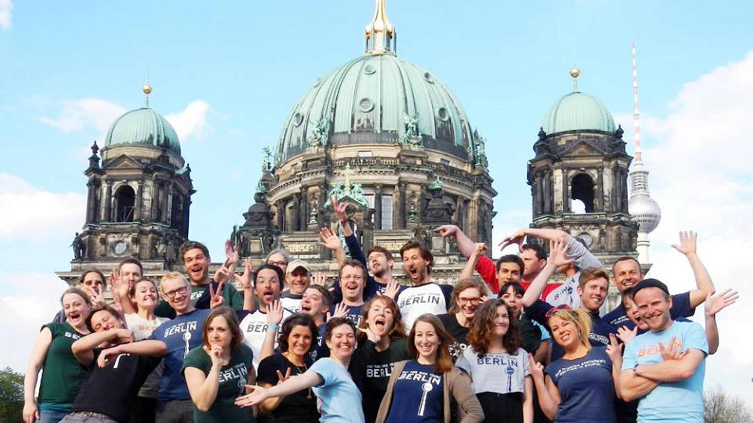 Tour group posing in front of the Berlin cathedral