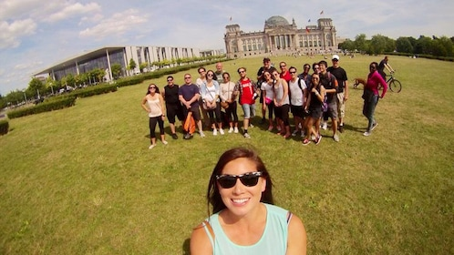 Tour group posing for a photo at a park in Berlin