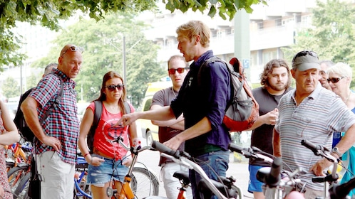 Bike tour group listening to their guide in Berlin