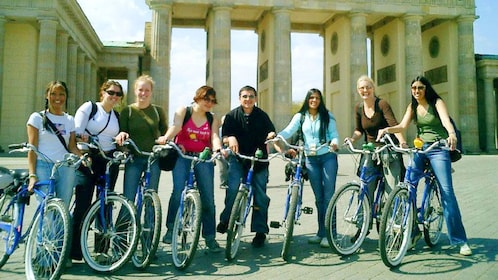 Tour group on bikes infront of the Brandenburg Gate in Berlin