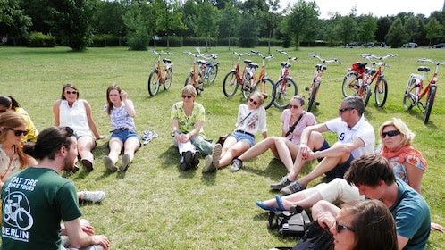 Tour group sitting in a field in Potsdam