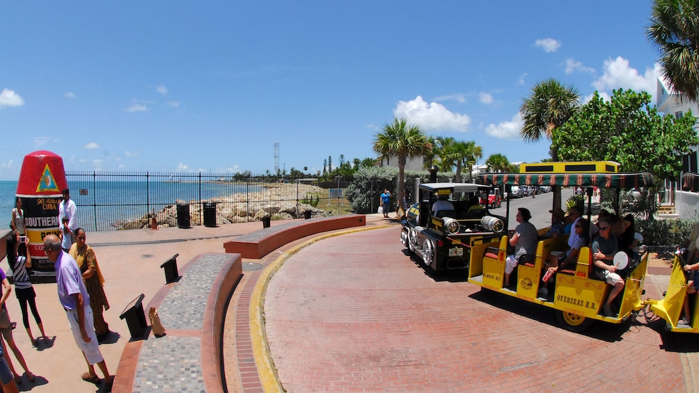 The Conch Tour Train near the ocean in Key West