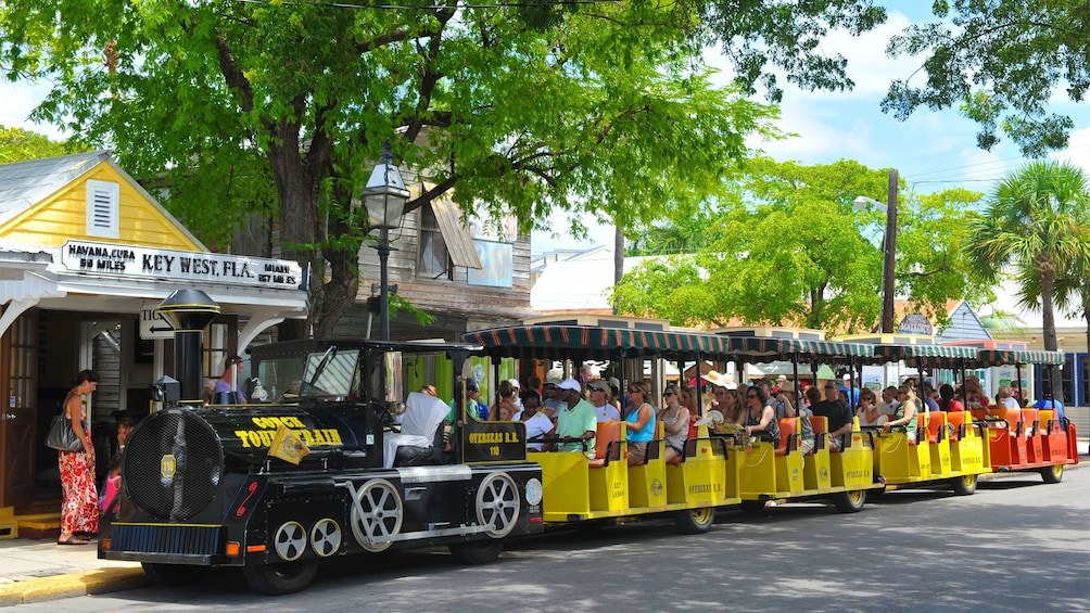Show item 1 of 8. Passengers enjoying the shade on the Conch Tour Train in Key West