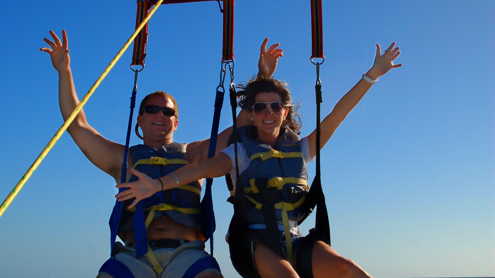 Couple parasailing in the sky at Key West