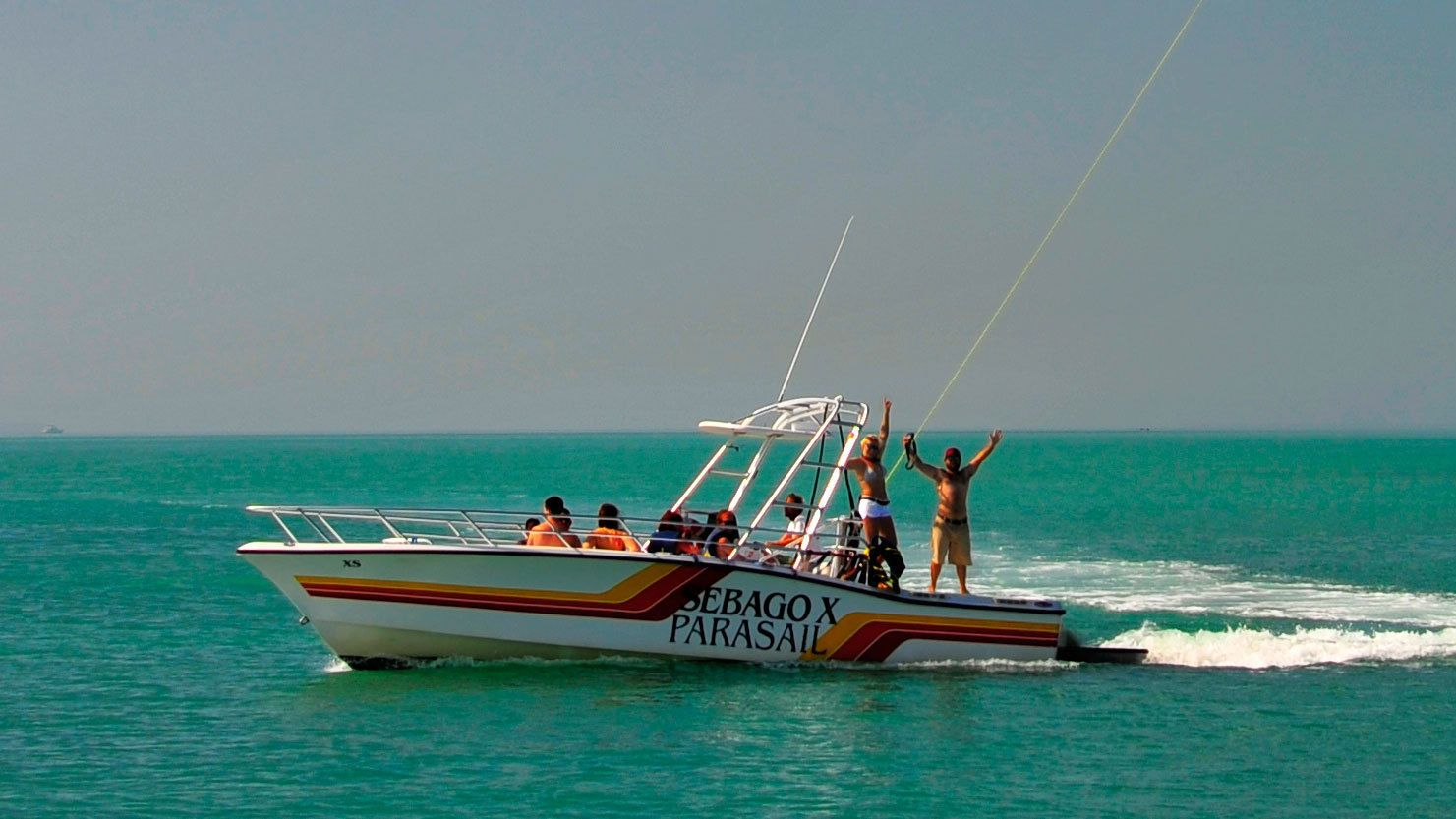 Speed boat tugging parasailers in Key West