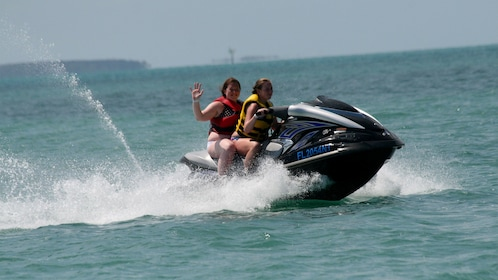 Friends having fun jet skiing in Key West
