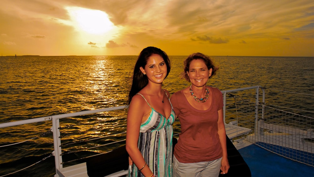 Family enjoying the sunset on the sailboat in Key West