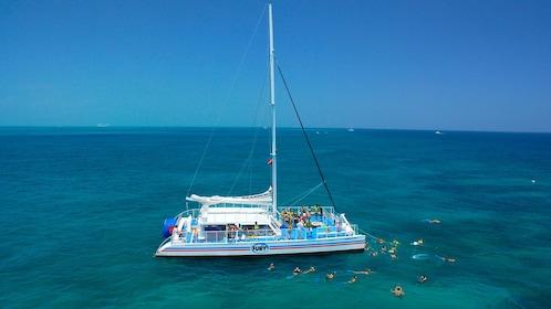 Snorkelers swim around the boat in Key West