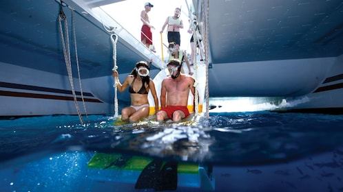 Couple in snorkel gear preparing to enter the water in Key West