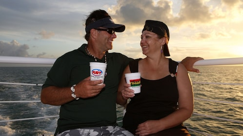 Couple enjoying rum in the sunset at Key West