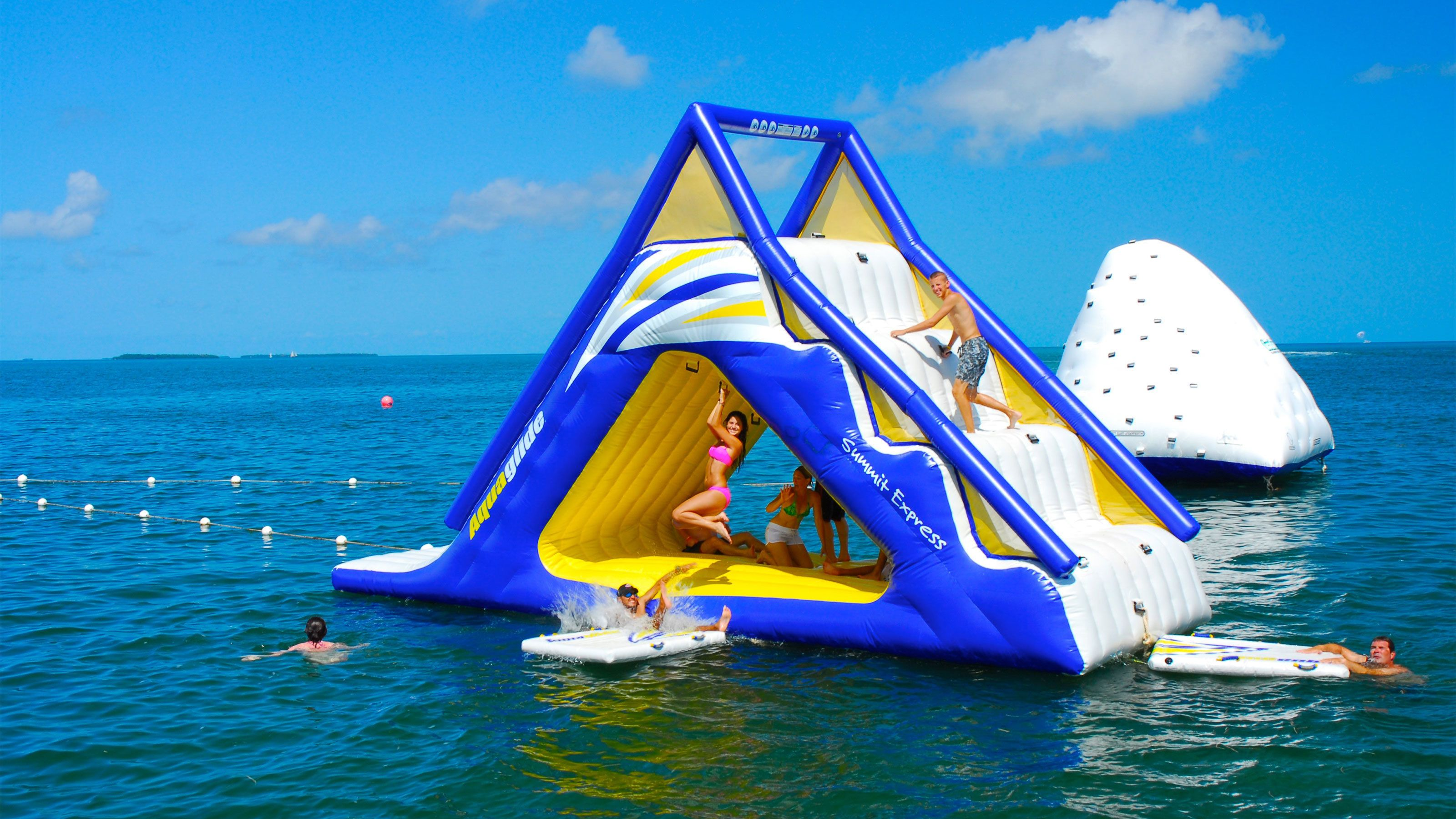 Inflatable slide and rock climbing wall above water in Key West