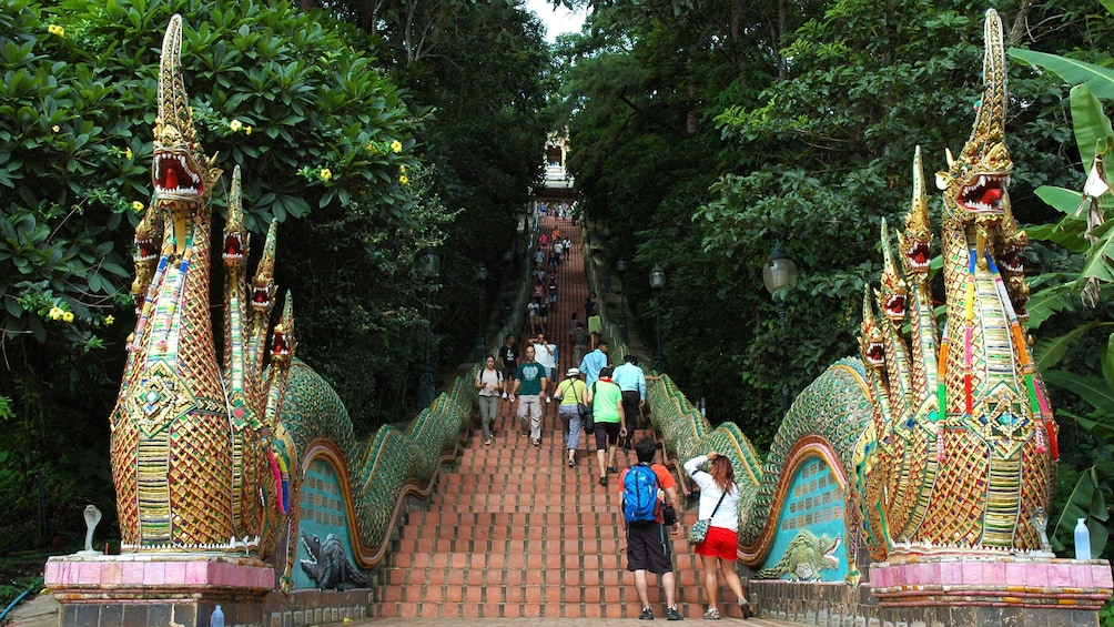 Show item 1 of 5. Ornate bridge with dragons in Chiang Mai