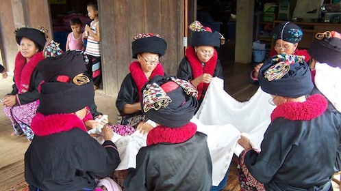 People wearing black and red outfits in chiang rai