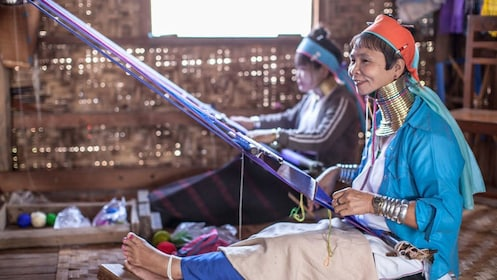 woman with coiled neck weaving in chiang rai