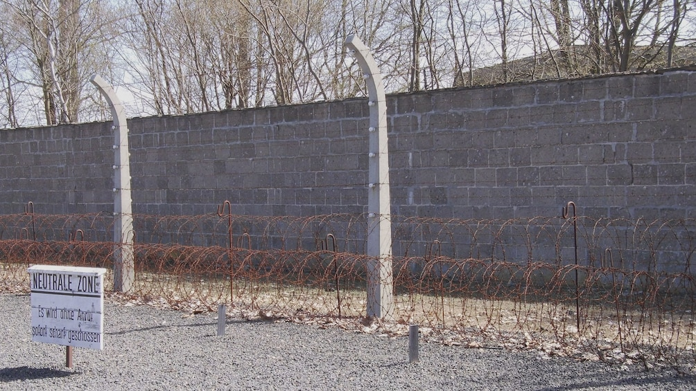 Show item 2 of 5. Wall of a cencentration camp in the Dachau Memorial