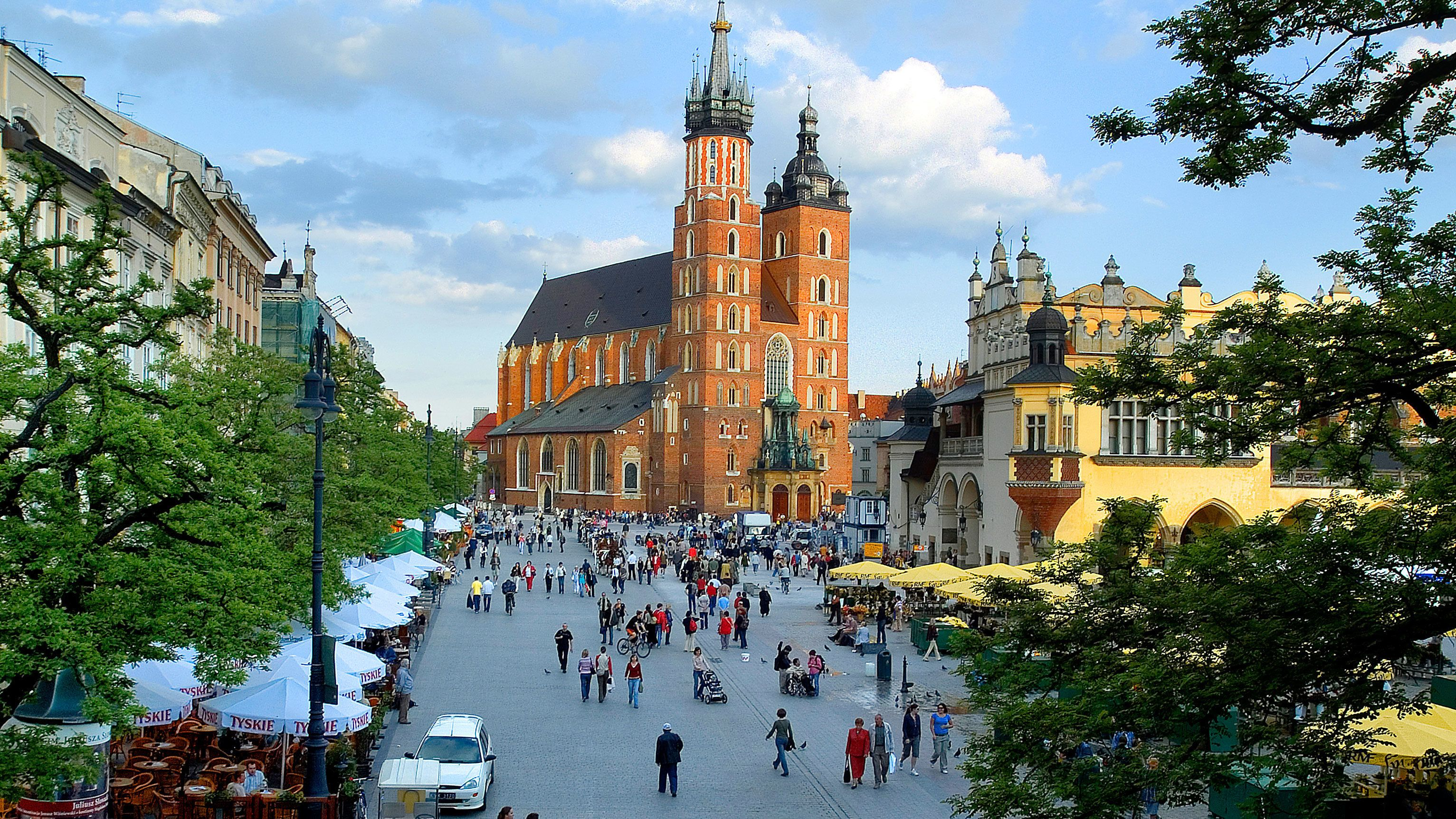 View of tourists walking around Kraków, Poland
