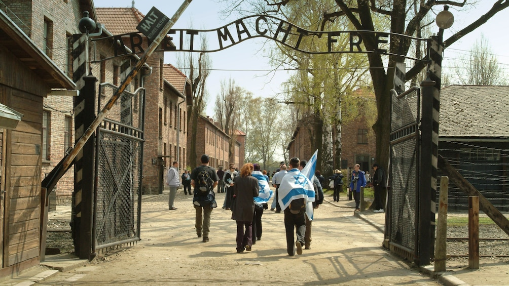 Show item 1 of 9. Tourists at the Auschwitz-Birkenau Concentration Camp in Poland