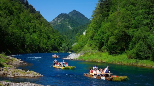 Guests enjoying a wooden raft trip down the Dunajec River in Poland