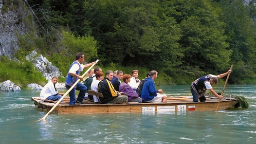 Close view of guests enjoying a wooden raft trip down the Dunajec River in Poland