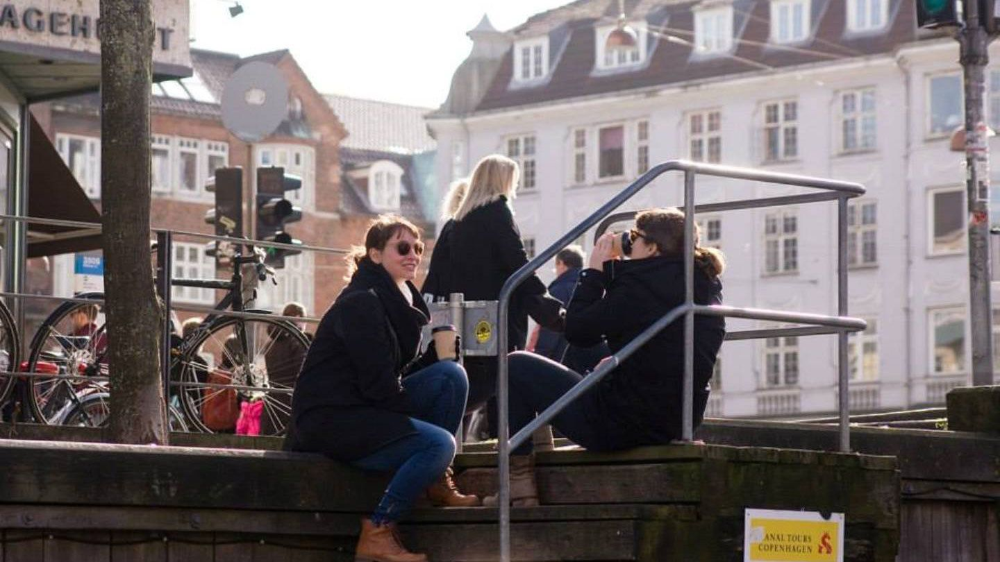 Drinking coffee on the stairs in Copenhagen