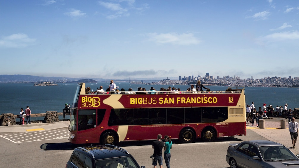Show item 1 of 10. Big Bus Sightseeing bus at the waterfront in San Francisco