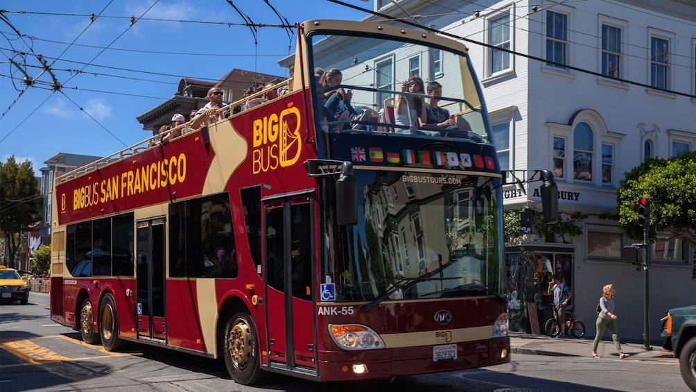 Show item 3 of 10. Sightseeing bus in the Haight-Ashbury district in San Francisco