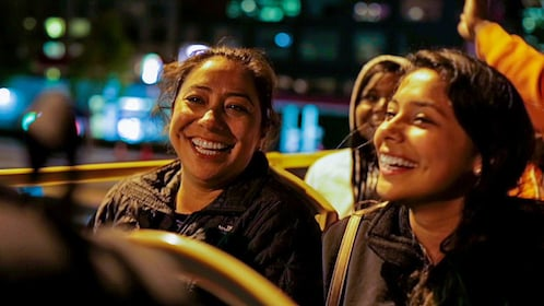 Smiling women on sightseeing bus in San Francisco