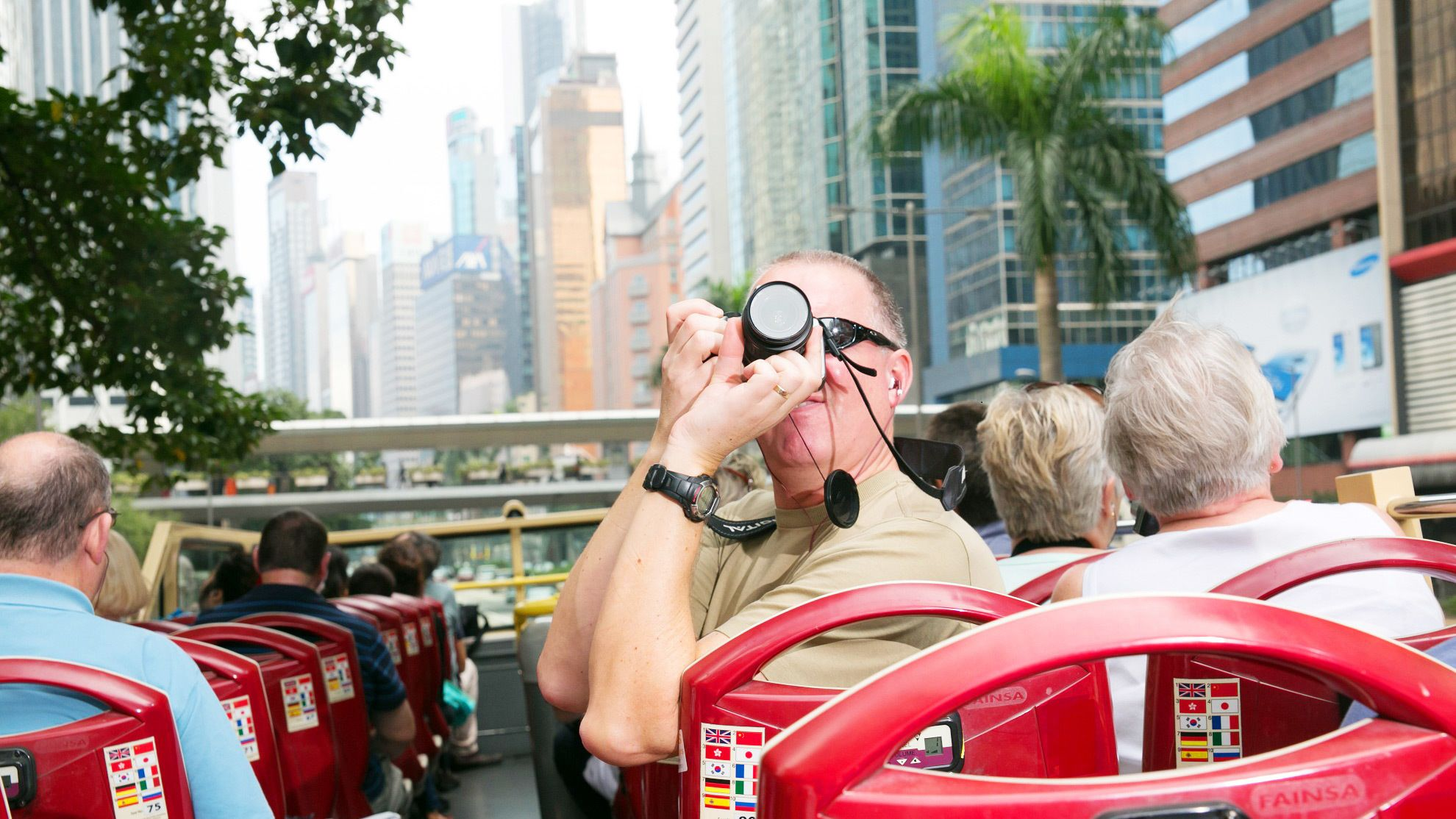 Taking photos from the top deck of the bus in Hong Kong