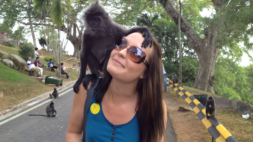 Show item 4 of 8. woman with a monkey in kuala lumpur