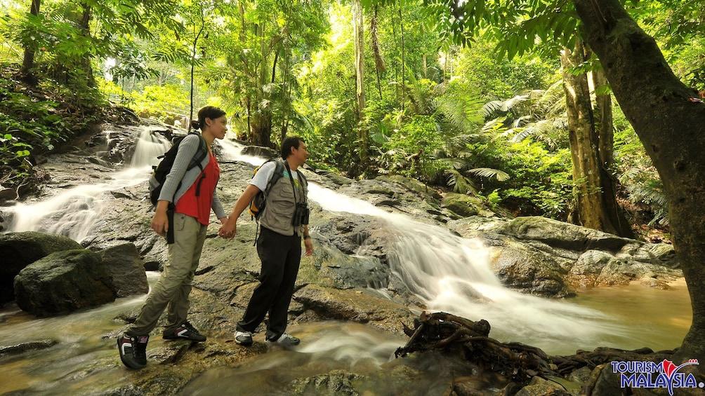 people hiking near stream in kuala lumpur