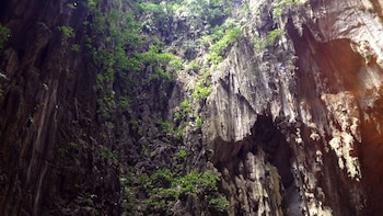 Show item 3 of 9. Cliff walls leading up to Batu Caves
