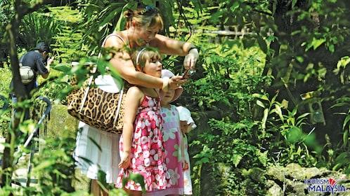 family taking photos in kuala lumpur