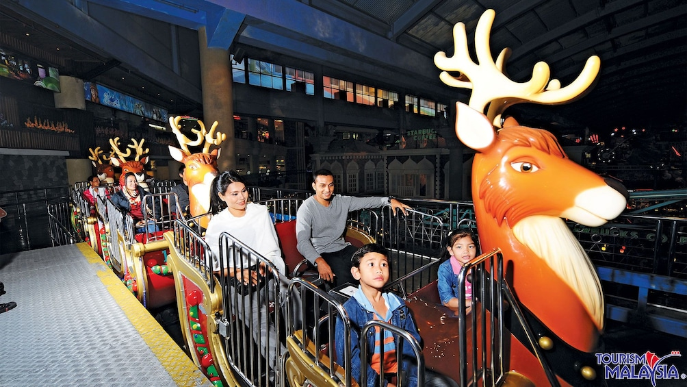 Show item 4 of 6. family on reindeer train in kuala lumpur