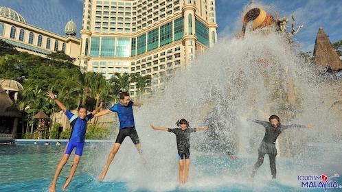 people jumping in fountain in kuala lumpur