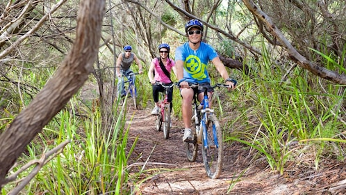 Bicyclists riding down a path on Kangaroo Island