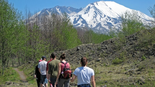 Hikers on a trail at Mount saint helens national volcanic monument in Washington