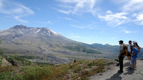 Hiker group looking at Mount saint helens national volcanic monument in Washington