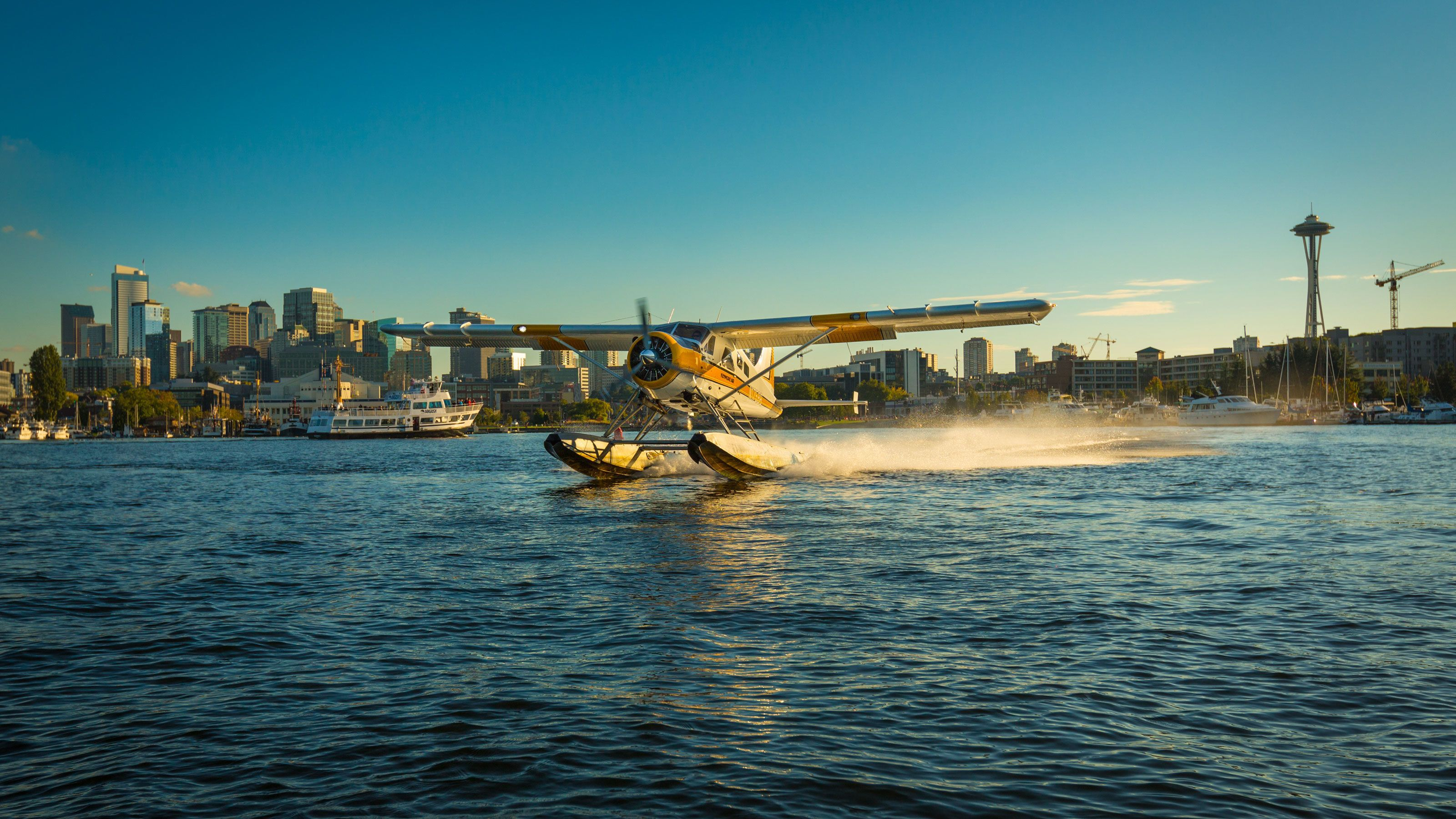 Float plane taking off on lake from Seattle