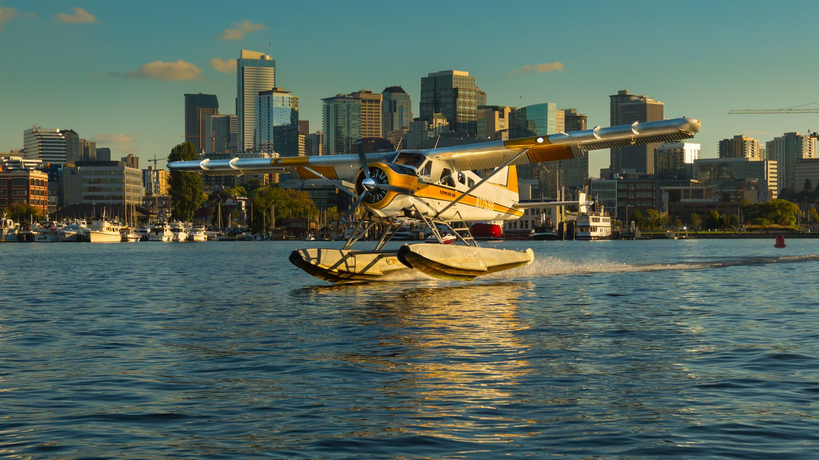 Seaplane landing on the water in Seattle Harbor